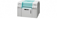 Frontier DE100 - <p>New professional photo printer for production in shop studio or labs. New high resolution print head 1200x1200 dpi for high quality prints. New print size 5x9cm with paper rolls in 89mm and a paper width of 50mm.</p>